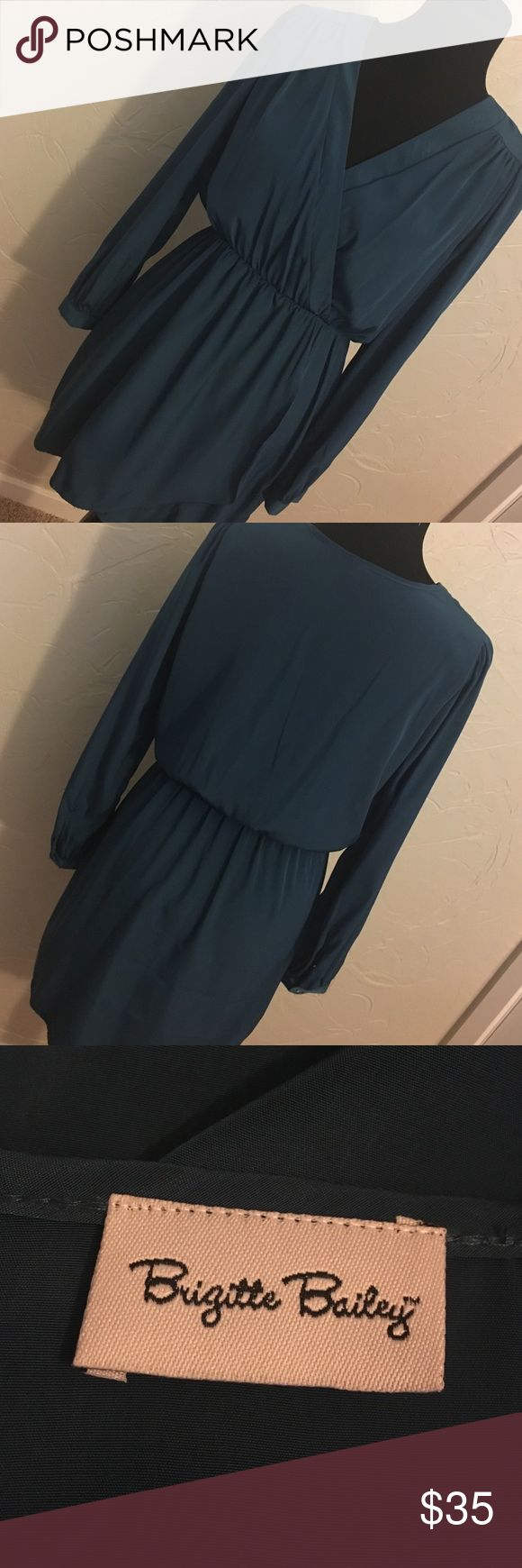 Blue long sleeve dress Blue long sleeve dress, sleeves are slightly billowy and flowy which compliments the straight skirt and faux wrap top Dresses