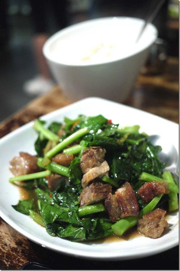 Pad kana moo groi or Stir-fried Chinese mustard greens with crispy roast pork $14.90