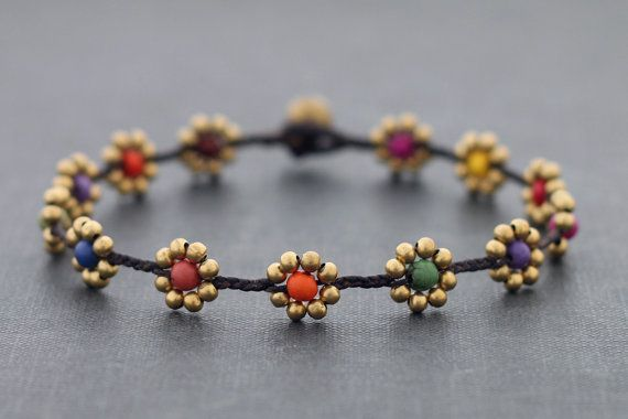 This is hand woven anklet made with dark brown cotton waxed cord weaved together with brass beads and a mixture of difference stone . Closure using