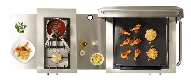 Westahl Table de cuisson pour cuisine extérieure Open'Cook composé d'un gril à pierres de lave, d'une plancha fonte et de deux feux vifs gaz. ©Westahl