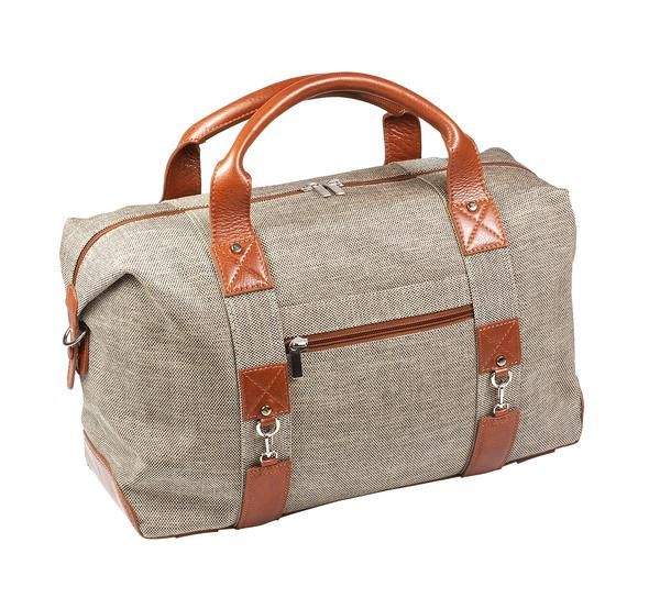 Travel lightweight for up to a week effortlessly. The Wing Man HoldAll by Ebby Rane was created to complement our signature carry-on, The Quartermaster Homme. Functional and sleek in well-appointed cognac leather and modern tweed, the Wing Man stands up to your travel agenda. Cabin size approved, featuring an ample interior, organizational pockets, and a 15-inch laptop/tablet sleeve, The Wingman will fly you solo for a weekend or pair precisely with The Quartermaster Homme for extended…