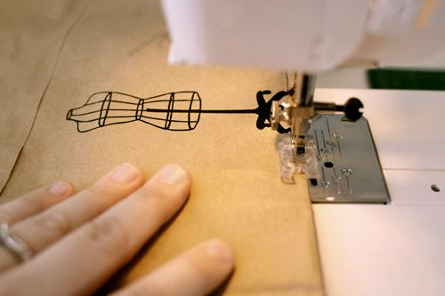 Idea - sewing brown paper into bags with bright thread and zig-zag stitches...