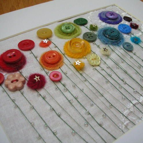 flowers from buttons and fiber