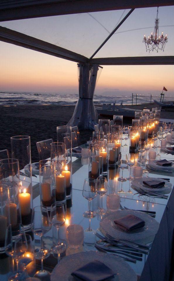 sunset, candlelight dinner on the beach..