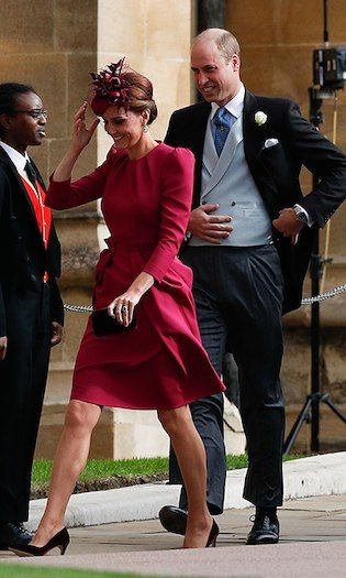 6c4aa38397 Kate was a vision in a fuchsia creation by Alexander McQueen, who famously  designed her wedding gown in 2011, and a hat by Philip Treacy. Her husband  looked ...