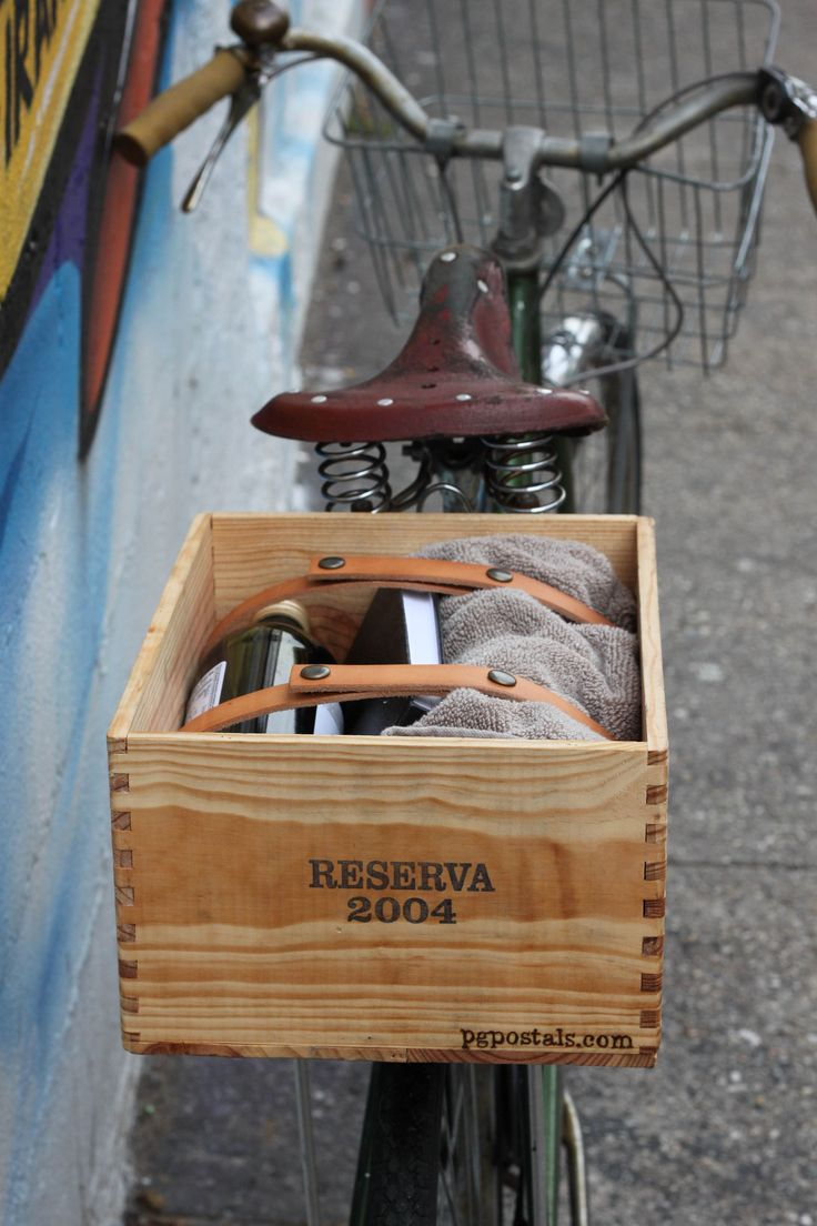 Secure your stuff! Great leather straps on this bike basket crate.