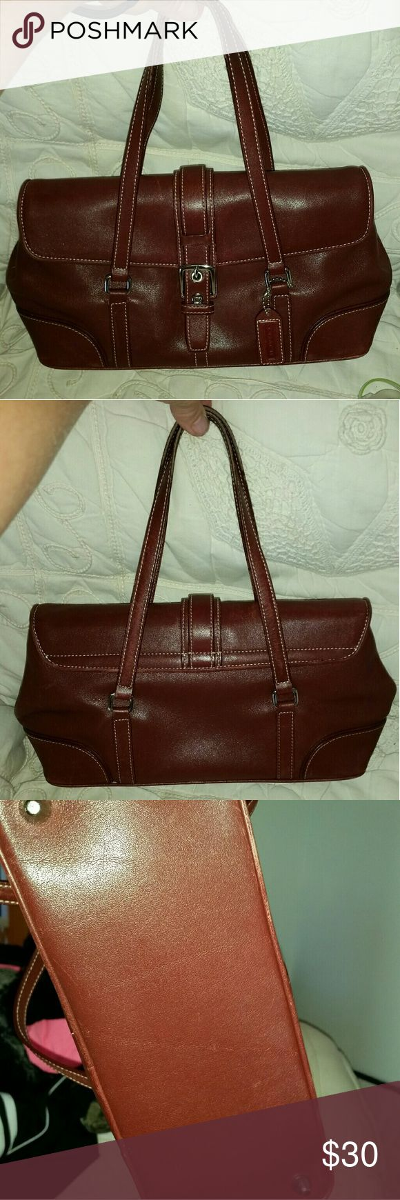 AUTHENTIC COACH TOTE BURGANDY COLOR This is a small authentic Coach tote leather its 12 by 8 smoke free home.no trades price is firm. NOTE.THIS IS A BURGANDY IN COLOR I HAD TO PICK RED Coach Bags Totes