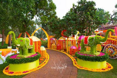 entrance decor,floral arrangement,elephant mural,interesting floral decor,unique decor,unique entrance decor