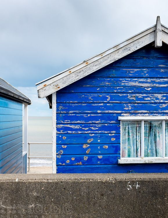 A close view of a beach hut at Southwold, UK, showing wear and corrosion in the painted wood