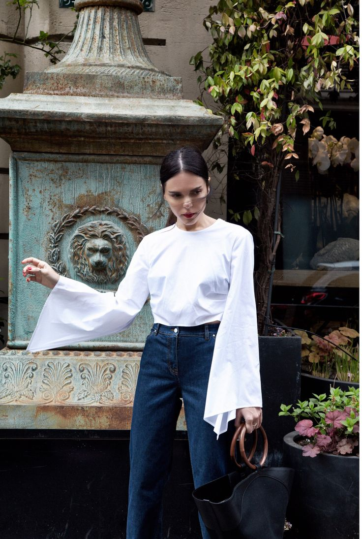 White bell sleeve top with high-rise jeans and circle handbag   Fashion Gone Rouge