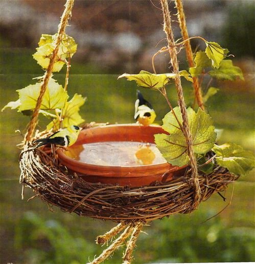 Simple birdbath made from a grapevine wreath, terracotta saucer, and rope