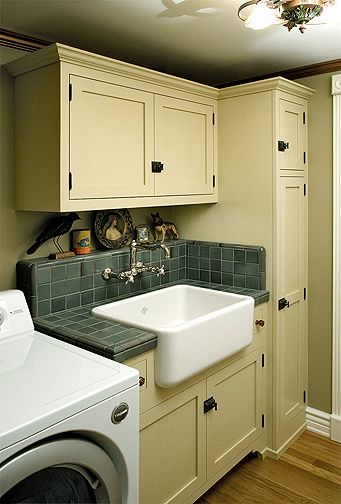 """Love laundry rooms with tons of storage! So much """"stuff"""" ends up in the laundry room. Also loving that sink!"""