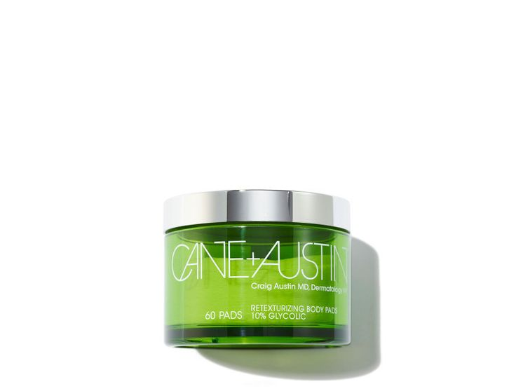 Cane + Austin - Retexturizing Treatment Body Pad Larger than their at-home facial glycolic acid peel pads, Cane + Austin's Retexturizing Body Pads are specifically designed to treat the body. Formulated to target uneven skintone or age spots, they can also help reduce the appearance of keratosis pilaris (those tiny red bumps that can appear on the upper arm). Simply swipe pad over affected areas and let the formula sink in. Violet Says: Use only in the evenings and apply ample amounts of…