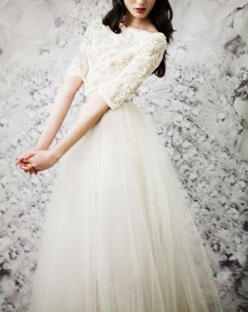 Starting to become more and more fond of wedding dresses with sleeves. There's a simple elegance about them.