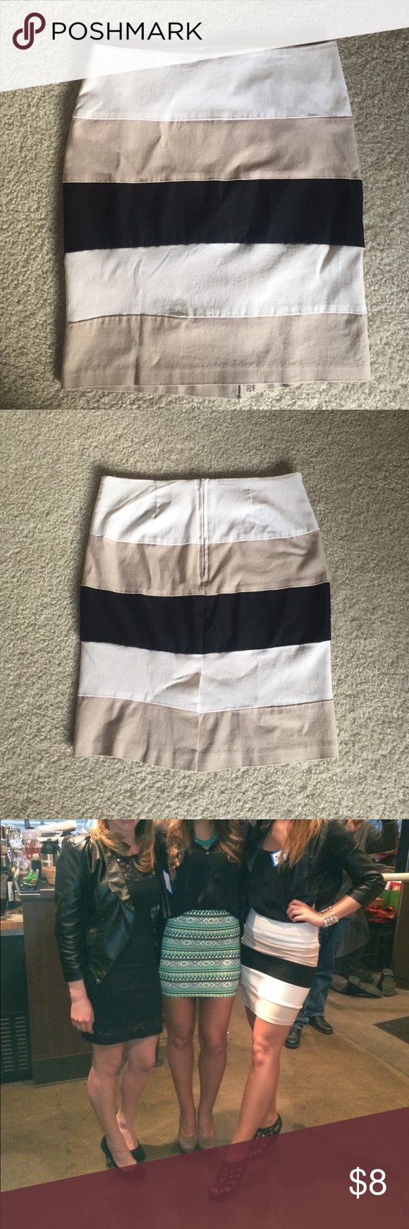 Striped (black, tan, white) Mini Skirt Striped black, tan/beige, and white mini skirt. Made of 74% rayon, 23% nylon, and 3% spandex. Has some stretch and very flattering. Rue21 Skirts Mini