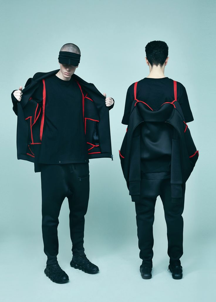 NEOPREN COAT by VAGUE innovative fashion design red on black neoprene coat carry your fashion carrying the jacket on your back black unisex fashion autumn winter 2017 collection israeli designers