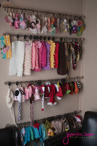 DIY Tutorial - organize Headbands, Scarves, Mittens, & Hats by attaching curtain rods to the wall with kids items hanging from shower curtain hooks.
