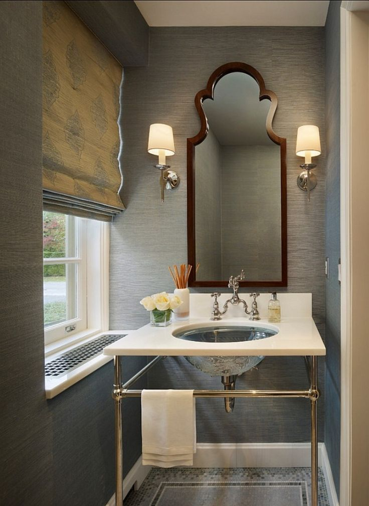 Roman #shades and subtle #grasscloth wallpaper adds luxury to a small powder #bathroom