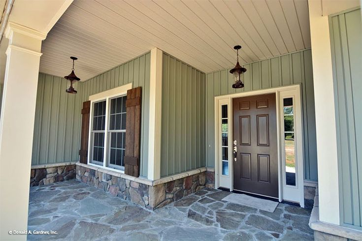 Rustic shutters frame this front window of The Tanglewood #757. http://www.dongardner.com/house-plan/757/the-tanglewood. #Rustic #Craftsman #FrontPorch