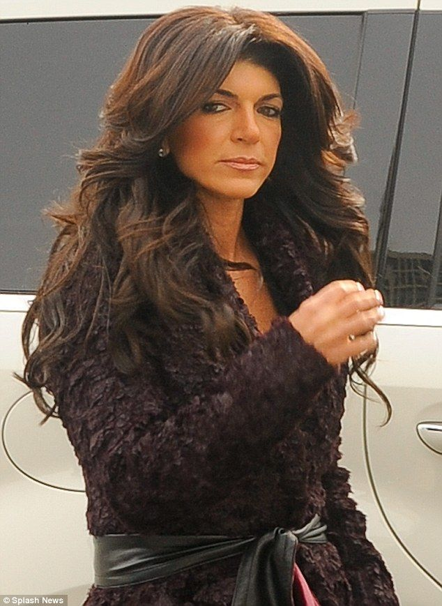 Court in the act: The Real Housewives Of New Jersey star seen here arriving at court sporting a full face of make-up and bouffant hair
