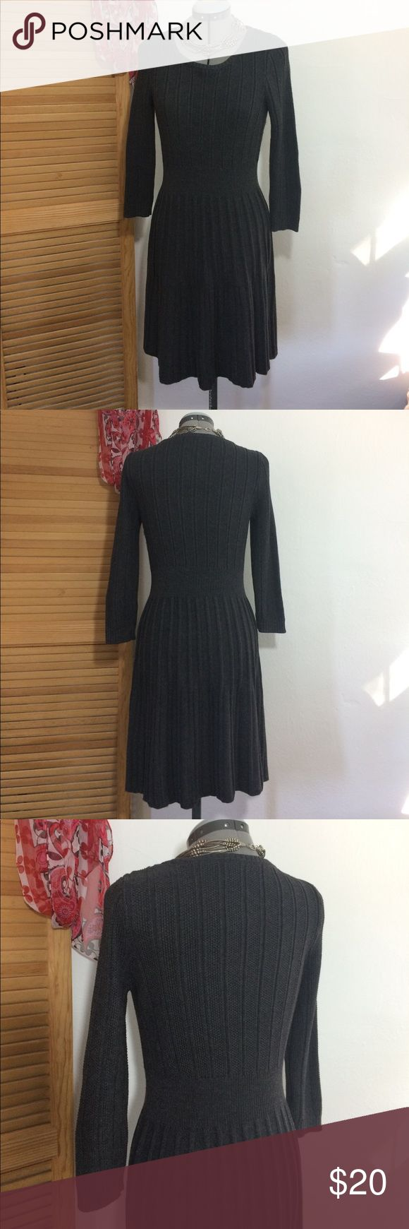 """Calvin Klein Dark Grey knit sweater dress. Sz. M Classic lines and cozy comfort marry in this dark gray sweater dress by Calvin Klein. Size medium. Plenty of stretch. Shoulder to arm cuff 21"""" which for most will be 3/4 sleeve. Waist to hem 22"""". Can be worn alone or under jacket/blazer. Flats/boots/heels. Matches with any color so options are endless. Will quickly become a wardrobe favorite due to its comfort, style and versatility.💐 Calvin Klein Dresses Midi"""