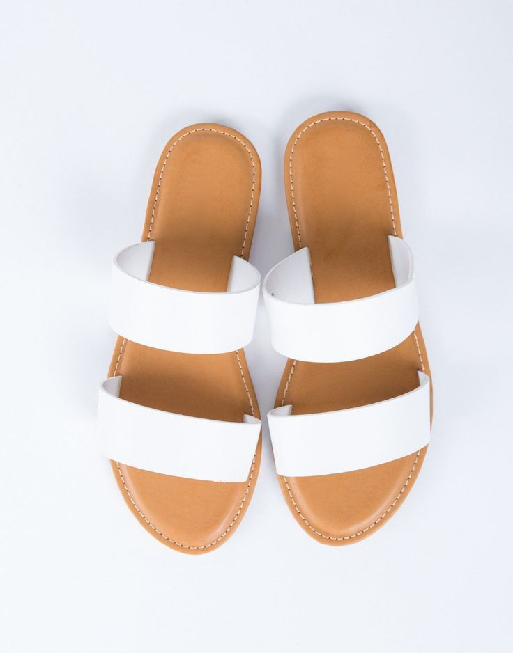 Featured: Spring Break Lookbook For those casual days out. These Double Banded Sandals are made from a faux leather material. Comes in a variety of colors. Features two wide bands with a lightly padde