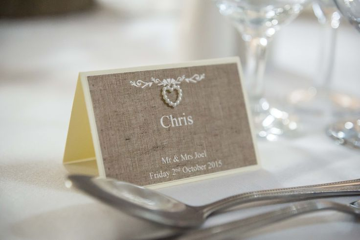 Sand coloured name tags with a lovely miniature pearl heart.