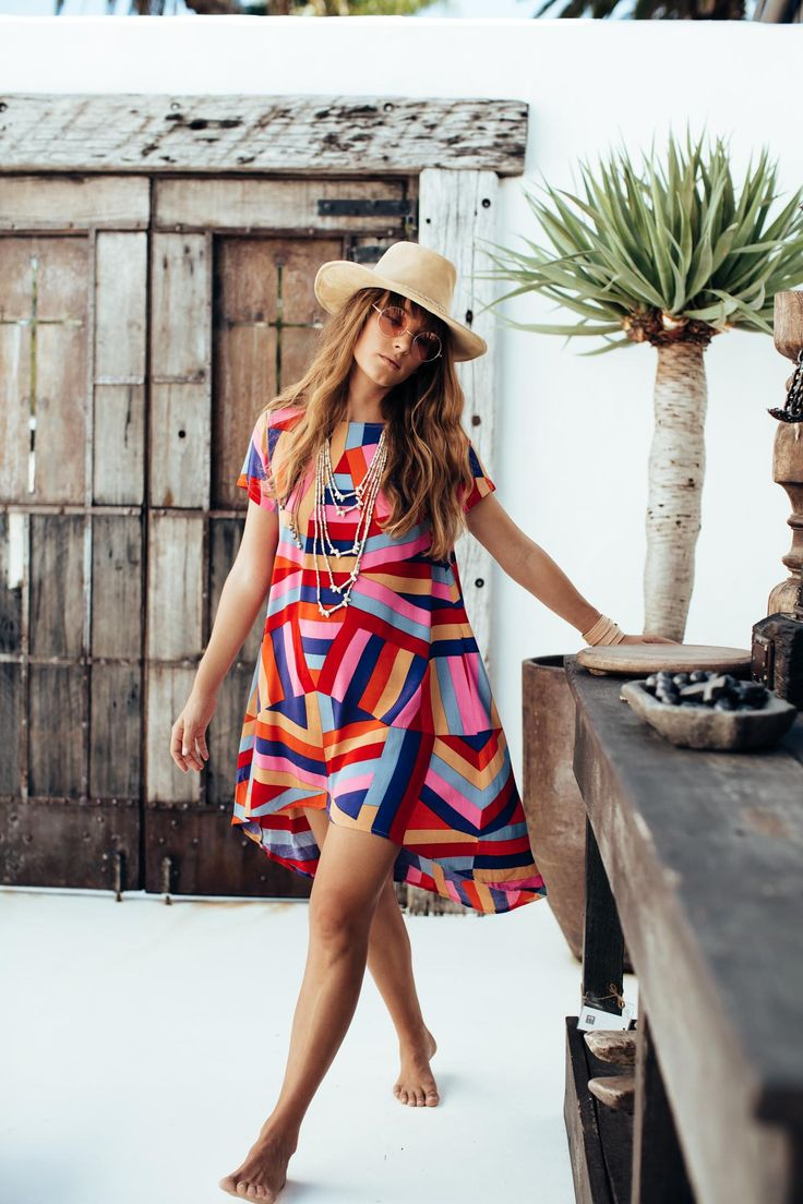 I love the style of this dress. The vibrant, bold colors are balanced out by their rectangular nature. The jewelry and hat are a nice finishing touch for this outfit as well.