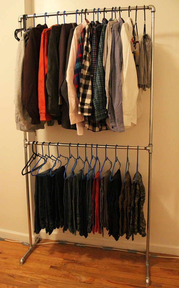 No closet? No problem! Check out how I built a pipe clothing rack for my son's clothing using plumbing pipe. Yes that's right, plumbing pipe!