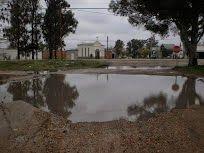 Noticias cercanas: Crece la laguna La lluvia del día hizo crecer  la laguna ubicada en Santa Teresita y Roberto Uncal, frente a Capilla Nuestra S.  de Lourdes EL CLIMA