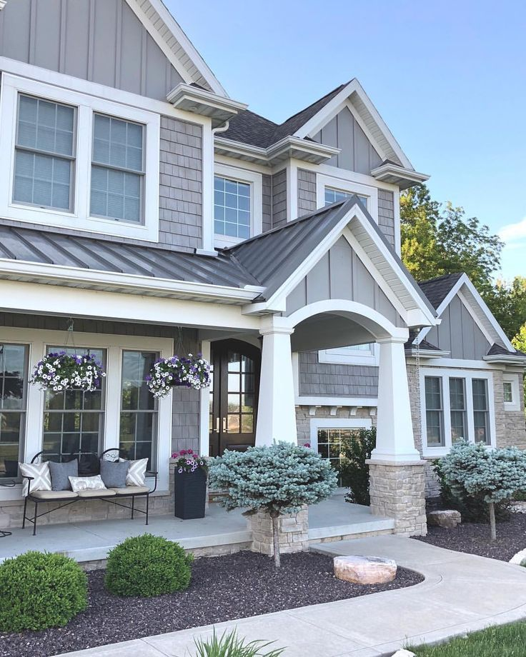 Home Exteriors: Grey And Stone Craftsman Style Home Exterior. Caroline On
