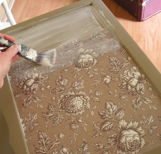 How to decoupage paper or fabric onto a damaged tabletop.