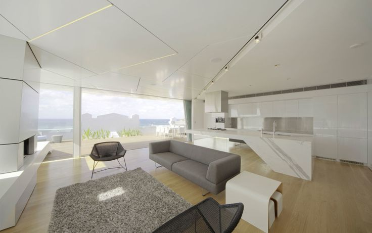 Apartments, Bondi Penthouse Design Interior In Kitchen And Living Space With Modern Furniture Used White Kitchen Furniture Decoration And Modern Grey Sofa Also Contemporary Rug And Chair: Apartment Interior Design with Lovely Wooden Floor and White Theme