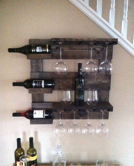 "This beautiful wine rack is made from reclaimed pine that I have painted black and distressed. It measures 24"" x 24"" with 3 shelves and wine glass holder. This rustic wine rack will look great in any"