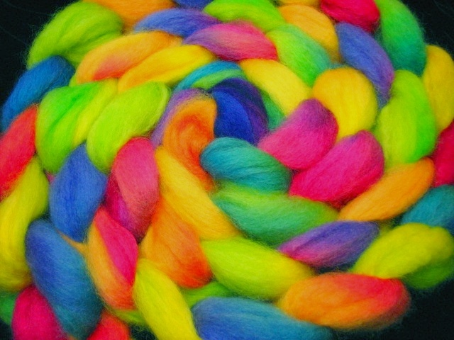 Small mill processed Romney wool hand dyed in juicy bright rainbow colors by The Painted Tiger.