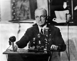 President Truman issued the Truman Doctrine, stating that it is the US's job to defend a democratic country who is being threatened by armed minorities (protect countries from communist threats).