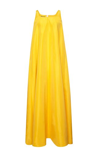 The iconic Parisian label **Rochas**, founded by Marcel Rochas at the age of 23, has since blossomed into a coveted collection of ready-to-wear and finely crafted accessories. Make your own sunshine with this vibrant yellow dress. A loose, A-line silhouette creates a effortlessly glamorous look.