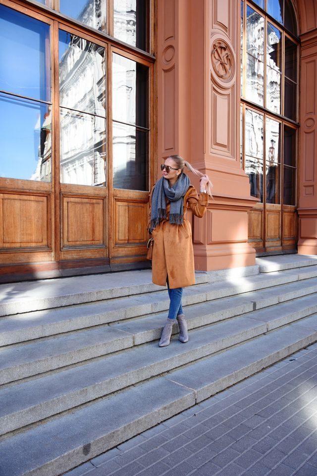 The brown trench coat