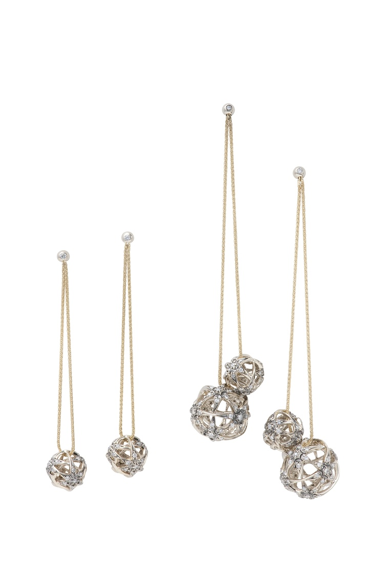 Copernicus Collection by H.Stern. Earrings in 18K yellow gold and polished Noble Gold with darkened finish and white diamonds.