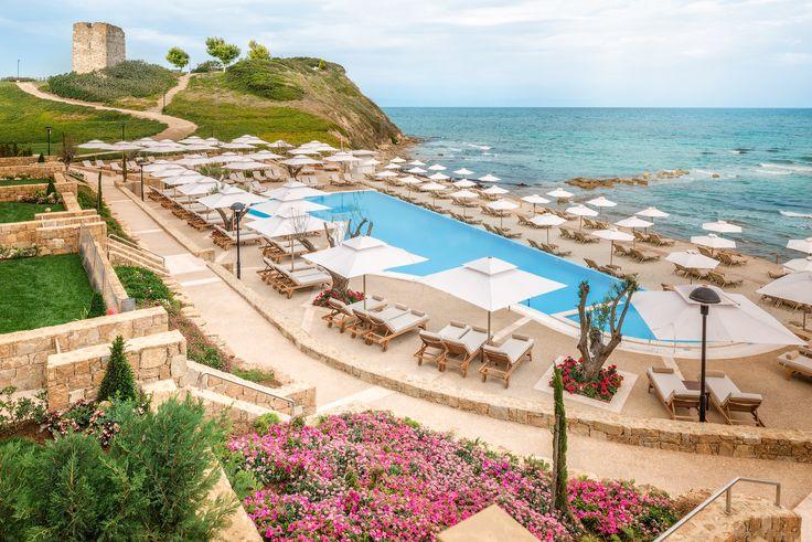 Sani Beach Hotel's stunning infinity edge pool promising beautiful sunset views, close to the picturesque Sani Hill beach. Location: Halkidiki, Greece