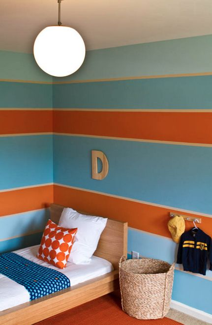 Blue, orange and cream. Oh my! Lovely colors for a child's bedroom.