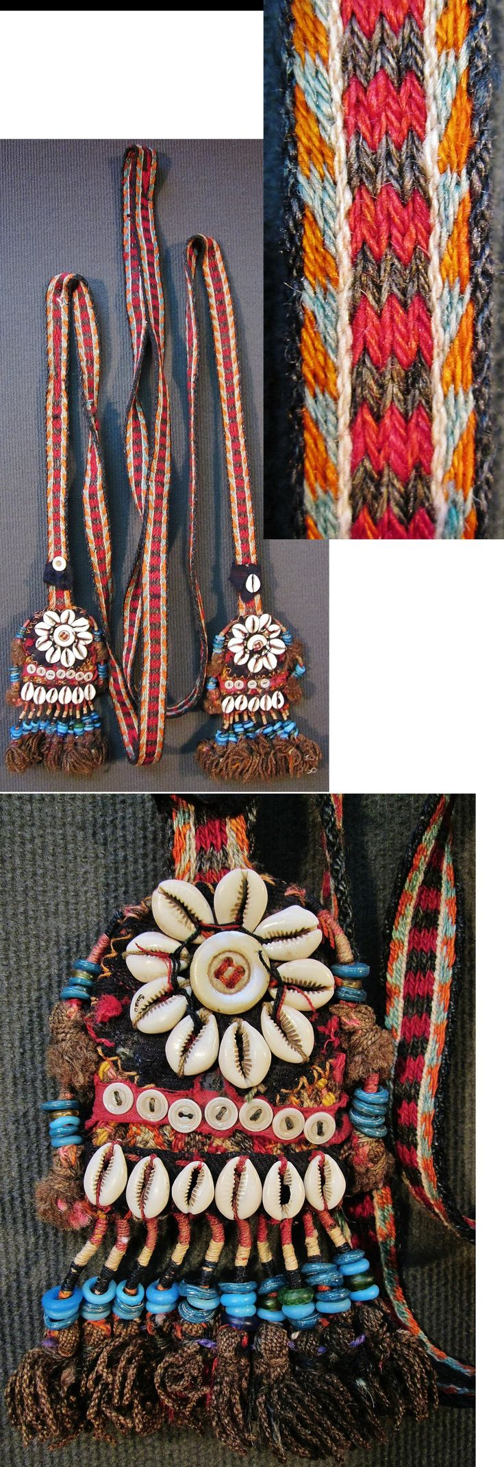 Woollen 'çarpana kemer' (card woven belt) for women, from the Dursunbey district (80 km to the East of Balıkesir), ca. mid-20th century.  Part of the local traditional rural festive costume.  The decorative endings feature cotton fabric, buttons, woollen fringes, blue & green glass rings (some of them of antique - Roman or early Byzantine - origin) and Cypraea shells (called 'deve boncuğu' in Turkey = camel's bead).  (Inv.n° çrp006 - Kavak Costume Collection - Antwerpen/Belgium).