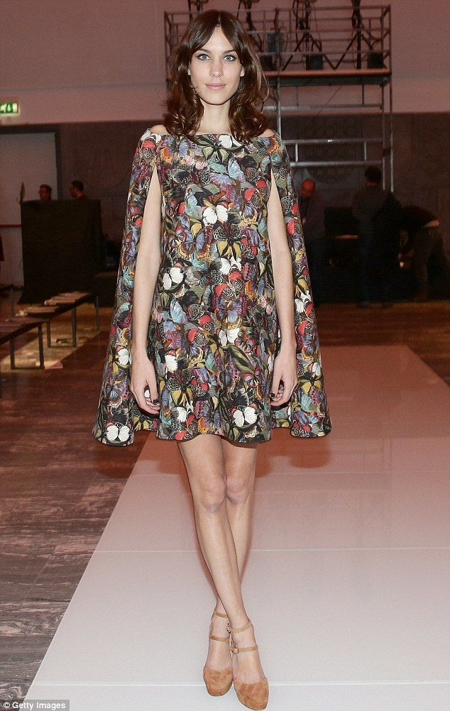Longest legs: Alexa Chung posed on the Woolmark Prize catwalk at Milan Fashion Week on Friday, wearing a butterfly print cape