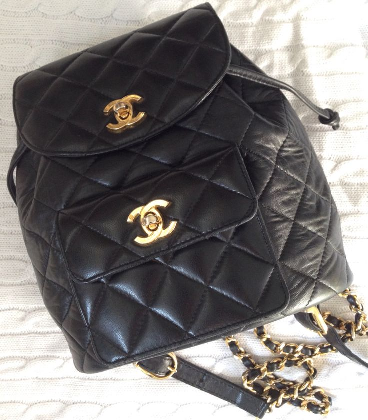 Vintage 1990s Chanel quilted black leather mini back pack with gold chain and leather straps