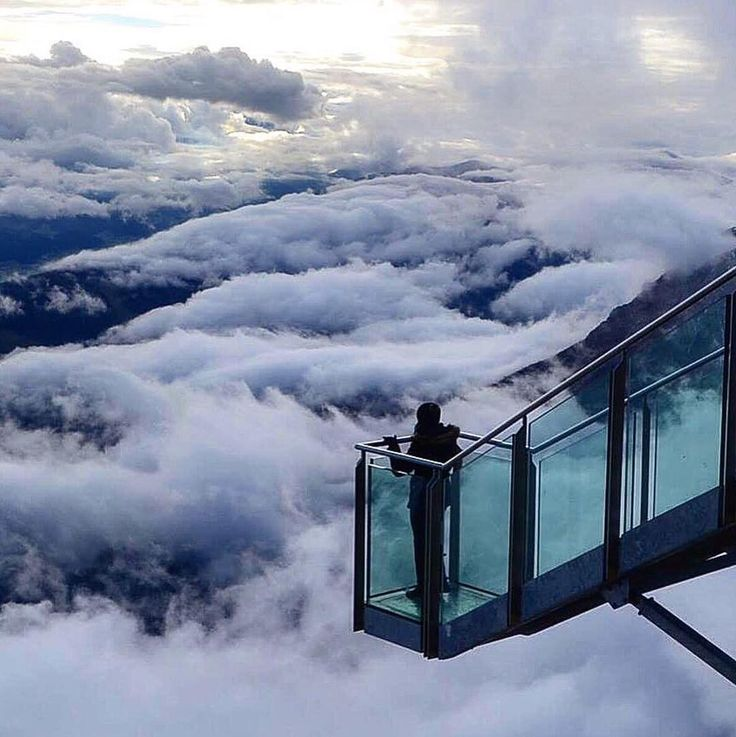 """Test your nerves at the """"Stairway to Nothingness"""". Here you get the chance to step onto a glass platform and experience a vertigo-inducing 400 meters above the Dachstein Glacier, at the Dachstein Glacier World in Schladming, Austria. On the way, take a gondola lift and cross a suspension bridge to reach the platform then continue further to the Sky Walk and explore the Ice Palace. Truly an experience that's above the clouds! Rad photo by @estellescope . . . . . #stairwaytonothingness…"""