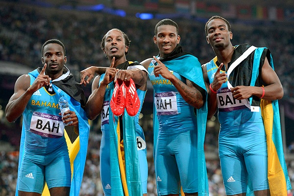 Chris Brown, Demetrius Pinder, Michael Mathieu and Ramon Miller of the Bahamas celebrate after winning the gold in the men's 4x400m relay final during the London 2012 Olympic Games.