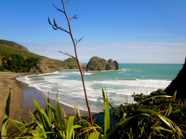 Piha, New Zealand. Love going here and climbing the big rock! Definitely wouldn't go swimming though...dangerous area.