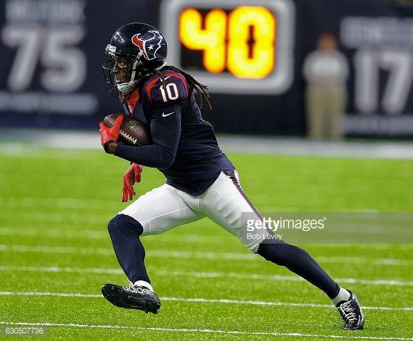 News Photo : DeAndre Hopkins of the Houston Texans breaks the...