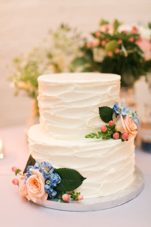 Two tier textured rose and hydrangea wedding cake: http://www.stylemepretty.com/massachusetts-weddings/wellesley/2016/11/23/mass-horticultural-society-wedding/ Photography: Meghann Gregory - http://meghanngregory.com/