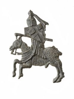 Badge This badge depicts a jousting knight. The knight carries a shield with the cross of St George, who became the patron saint of England during the wars with France in the 1300s.  Production Date: Late Medieval; early-mid 14th century